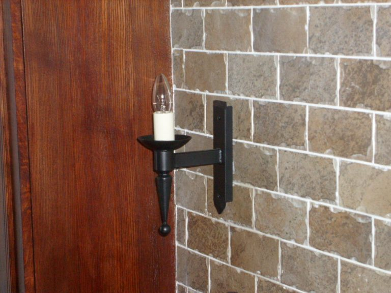 Hand forged wrought iron Aldwick single smooth point and ball wall light