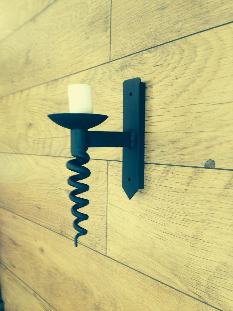 Hand forged wrought iron Bacchus single wall light